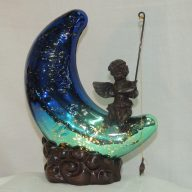 cherub on moon with fishing pole accent lamp