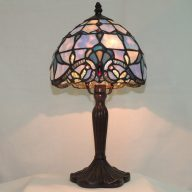 scallop blue opal effect lamp with fleur de lis accents.